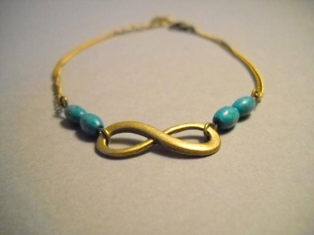 """Bracelet """"infini"""" bronze/vert 12 euros"""